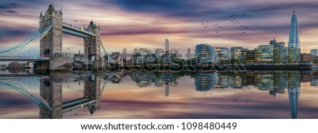 The skyline of London after sunset time: Tower Bridge and Thames riverside