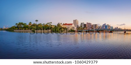 The skyline of the historic city of Recife in Pernambuco, Brazil by the Capibaribe river at sunset. #1060429379