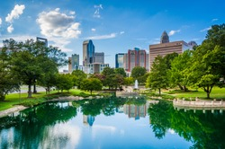 The skyline of Uptown Charlotte, and lake at Marshall Park, in Uptown Charlotte, North Carolina.