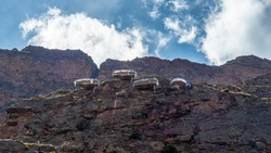 The Skylodge Adventure Suites, A transparent luxury capsule hanging from the top of a mountain in the Sacred Valley, Peru.