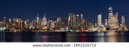 The skyscrapers of Manhattan skyline at twilight. Midtown West cityscape from across Hudson River, New York City, NY, USA Stock photo ©