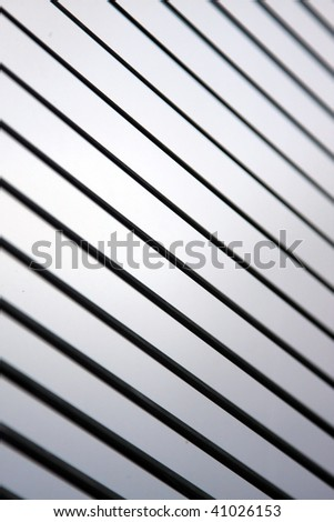 The slats of a Venetian blind, focused on center with light gradient