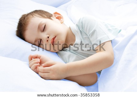 The sleeping boy - stock photo