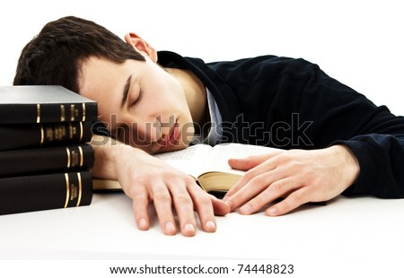 The sleeping student with books isolated on a white