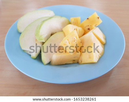 The sliced fruit contains guava and pineapple.