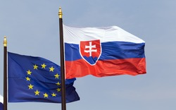 The slovakian flag in front of the presidental palace in Bratislava