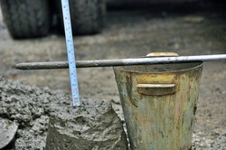 The slump test is the process of testing the value of the collapse / dropping of the concrete mix sample from the height of the truncated cone