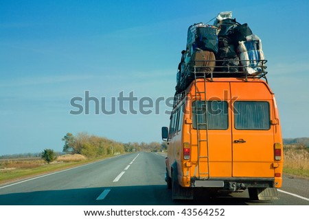 the small bus with bags on a...