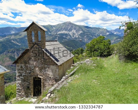 The small chapel in the village of Amen in the Alps of the French Provence is high up on a beautiful hiking trail. You will be rewarded with a panoramic view of the mountain ranges of the Alps. #1332334787
