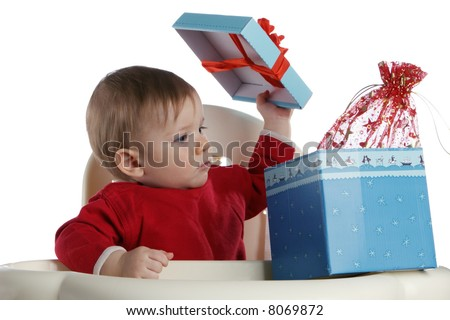 The small child opens a box with a gift