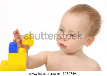 The small child plays the designer a white background