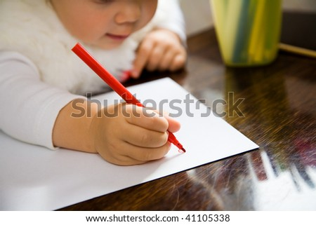 The small child writes the letter to Santa - stock photo