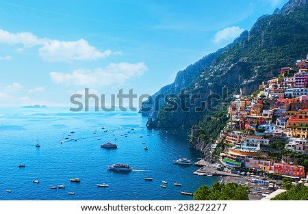 The small haven of Positano village with the tiny beach and colorful houses, located on the rock, Amalfi coast, Italy.
