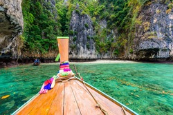 The small Monkey beach in paradise Bay - about 5 minutes boat ride from the Ao Ton Sai Pier - Koh Phi Phi Don Island at Krabi, Thailand - Tropical travel destination