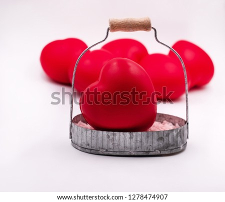 The small red heart put in aluminium basket ,blurry light around,Love and care concept #1278474907