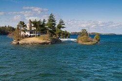 The smallest international bridge connecting two of Thousand Islands on Saint Lawrence River - one island is USA and other is Canada