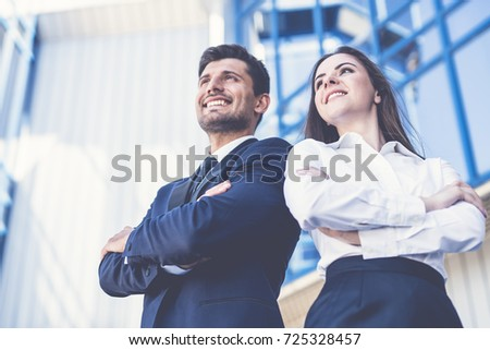 The smile man and woman stand on the background of the office center Foto stock ©