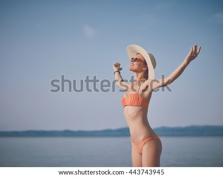 The smiling woman with open arms enjoys the holiday #443743945