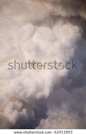 The smoke from the chimney at the power plants