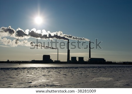 The smoke goes from pipes in a view of the sun