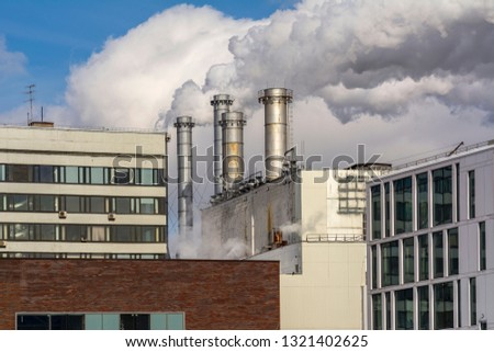 The Smoking chimneys of factories and office buildings manufacturing. #1321402625