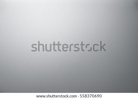 The smooth surface texture of the metal panel