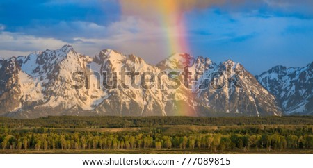 The snow capped mountains of The Grand Tetons in this National Park is breathtaking and natural beauty at its best. Although spring newness has begun in the valley, the high n mountains still white