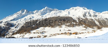 The snow-covered Grosse Moosstock and the other mountains of the Durreckgruppe towering above the village of Rein in Taufers in South Tyrol, Italy.