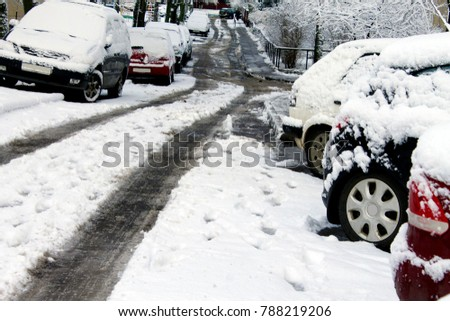 The snow-covered side of the car with crystal white snow, the distant road #788219206