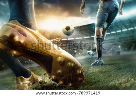 The soccer football players at the stadium in motion #789971419