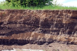 The soil. Layers of soil for research under construction.