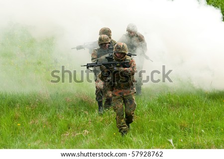 The soldier of the Bundeswehr in the zone of military operations. In the smoke.
