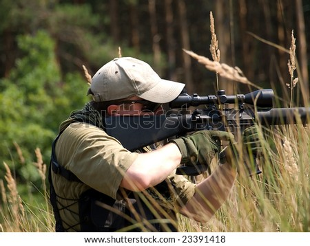 The soldier shooting - stock photo