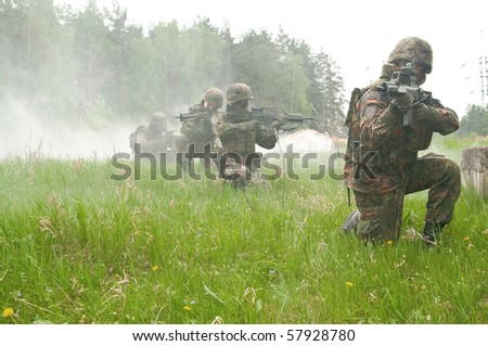 The soldiers of the Bundeswehr in the zone of military operations. In the smoke.