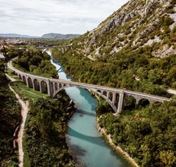 The Solkan Bridge is the longest stone bridge. The bridge connects Slovenia and Italy. Railway bridge in the mountains across the blue river Soca. Located in the west of Slovenia.