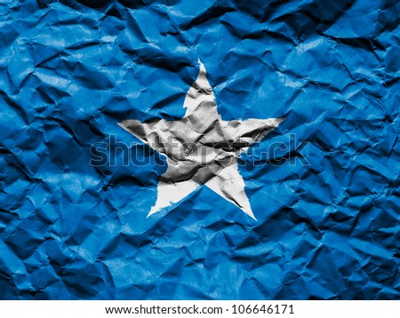 The Somalia flag painted on crumpled paper