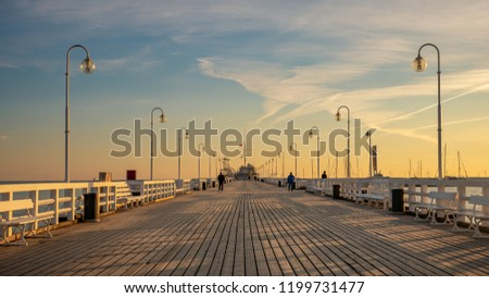 The Sopot Pier in the city of Sopot. The pier is the longest wooden pier in Europe. Beautiful sunrise.