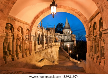 The south gate of the Fisherman's Bastion in Budapest - Hungary at night