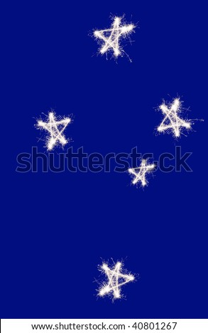 The Southern Cross constellation of Crux as represented on the Australian and New zealand flag, drawn in sparkler trails