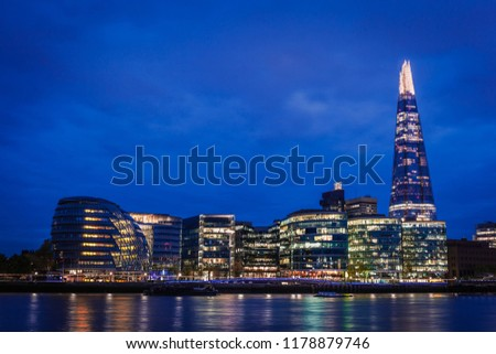 The Southwark skyline over the river Thames at night, London, United Kingdom #1178879746
