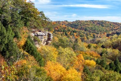 The southwestern Ohio autumn landscape is painted with the colors of fall leaves as viewed high above the trees and rock walls of Conkle's Hollow in the beautiful Hocking Hills.