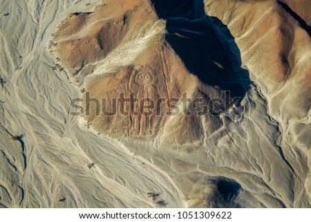 The Spaceman (or Owl Man, or Astronaut) of Nazca Lines, aerial view from aircraft, Peru. #1051309622