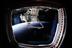 The SpaceX Crew Dragon spacecraft is docked to the International Space Station. Elements of this image furnished by NASA.