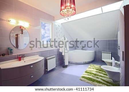 The spacious modern bathroom which has been laid out by a tile
