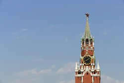 The Spasskaya Tower with blue sky in Moscow, Russia. The 'Saviour Tower' is the main tower on the eastern wall of the Moscow Kremlin which overlooks the Red Square.
