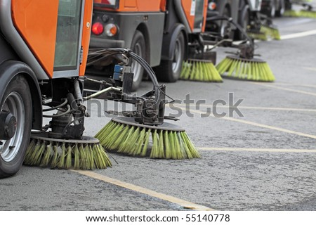The special car cleans city road - stock photo