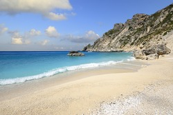 The spectacular Aspri Ammos beach on the rocky southwest coast of the Greek island of Othonoi in the Ionian Sea
