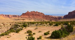 the spectacular red rock buttes of the black dragon wash in the san rafael swell on a sunny fall day,  near green river, utah