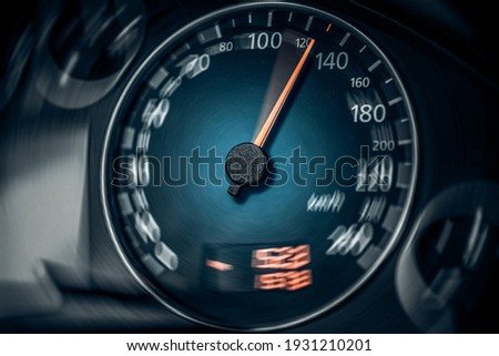 The speedometer of a modern car shows a high driving speed. Added motion blur. Photo stock ©