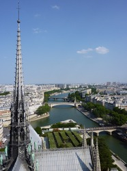 The spire of the Notre-Dame Cathedral in Paris before being destroyed by the 2019 fire gazes imperiously at the River Seine